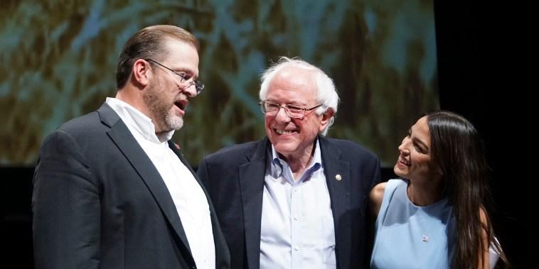 Image: Kansas congressional candidate James Thompson, left, U.S Sen. Bernie Sanders, I-Vt.,  and Alexandria Ocasio-Cortez