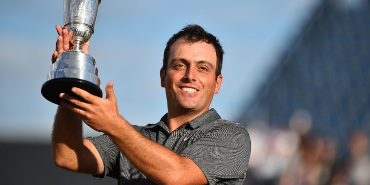 Image: Italy's Francesco Molinari poses for pictures with the Claret Jug