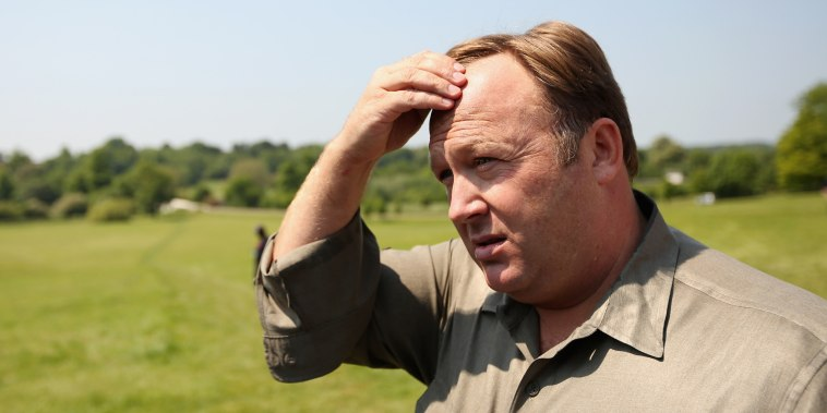Image: Alex Jones addresses media and protesters in Watford, England