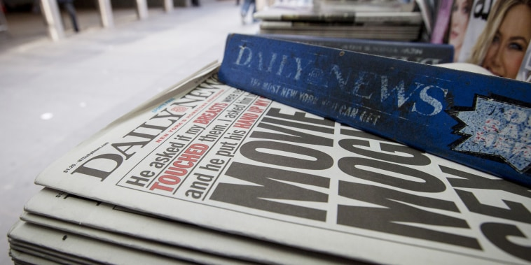 Copies of the New York Daily News are displayed on a newsstand in New York