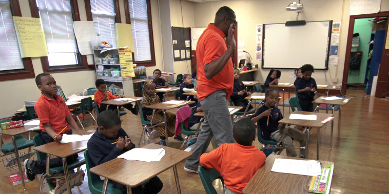 First-graders listen to teacher Dwane Davis at Milwaukee Math and Science Academy, a charter school in Milwaukee, in 2017.  Charter schools are among the nation's most segregated, an Associated Press analysis found -- an outcome at odds, critics say, with their goal of offering a better alternative to failing traditional public schools.