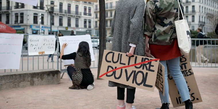 A woman holds a banner reading 'Rape culture' during a demonstration to support the wave of testimonies denouncing cases of sexual harassment, in Lyon, central France on Oct. 29, 2017.