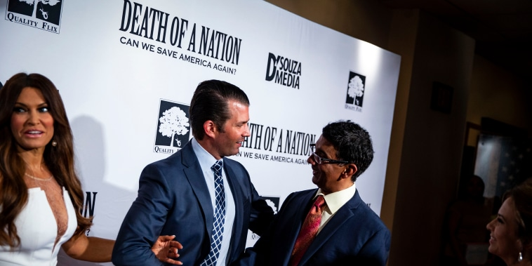 Image: Donald Trump Jr. shakes hands with Filmmaker Dinesh D'Souza