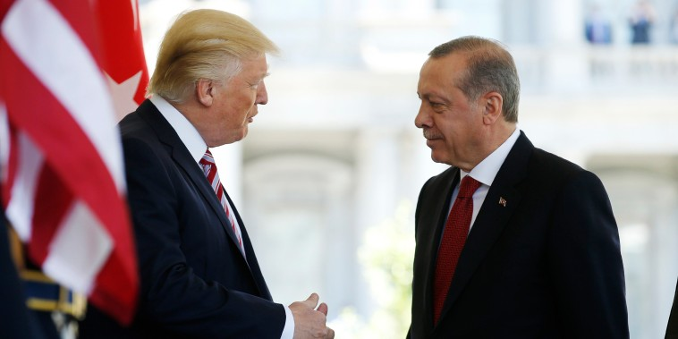Image: Trump greets Turkey's President Erdogan at the entrance to the West Wing of the White House in Washington