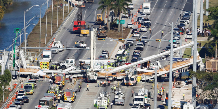 Image: Aerial view shows a pedestrian bridge collapsed at Florida International University in Miami