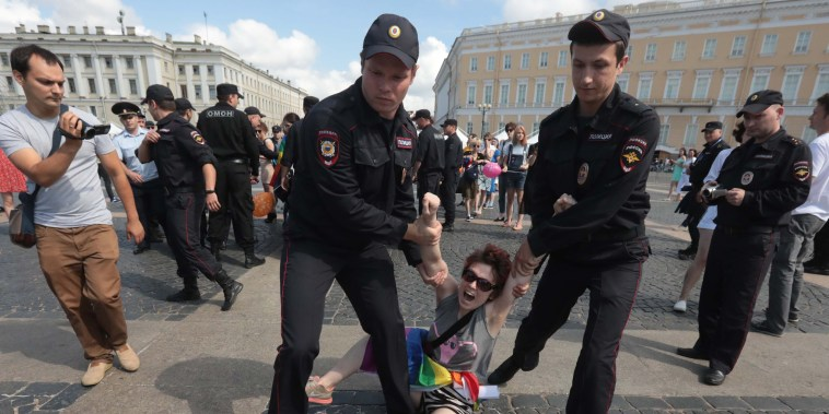Image: A demonstrator is detained by police during the LGBT community rally in central St. Petersburg
