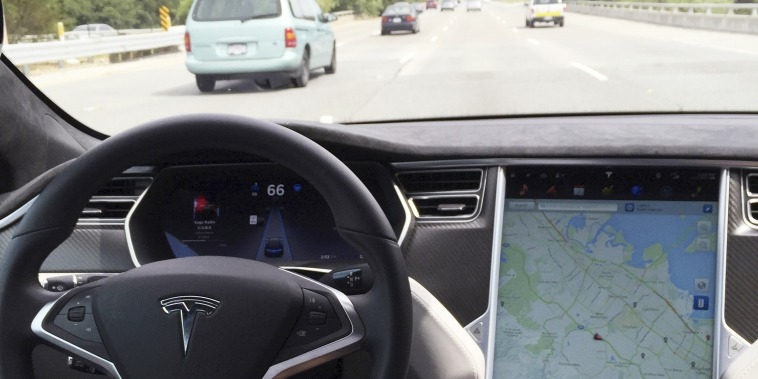 Image: The interior of a Tesla Model S in autopilot mode in San Francisco