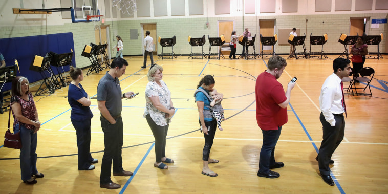 Image: Voters wait in line to cast their ballot during Ohio's 12th District special congressional election