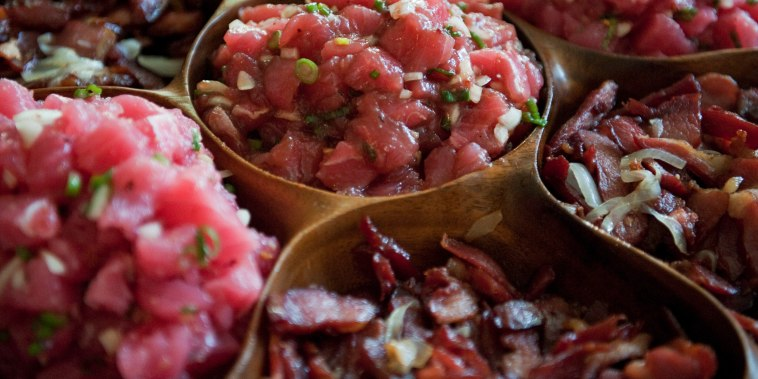 Poke is a Hawaiian seasoned raw fish dish.