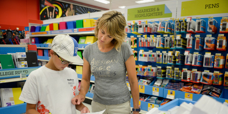 Image: Jill Courtney shops for school supplies for her son Will at a Target store in St. Joseph, Mo., on July 30.