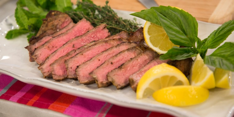 Grilled steak with lemon and herb marinade.