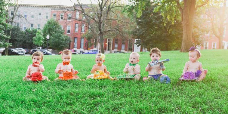 To celebrate her rainbow baby, Charlie's, first birthday, Alicia Lewis and her friends staged a multi-baby, rainbow photo shoot.