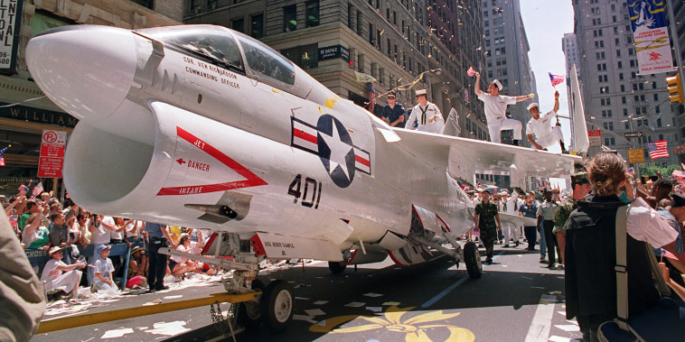 A Navy A-7 Corsair jet is pulled down Br
