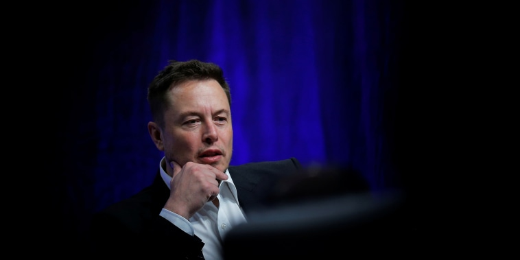 Image: Tesla Motors CEO Elon Musk speaks in Providence