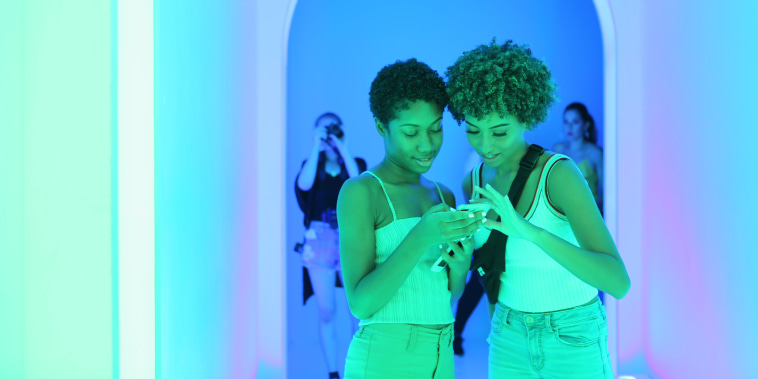 Image: Sarah Gio and Gia Gonzalez examine their photos at Dream Machine