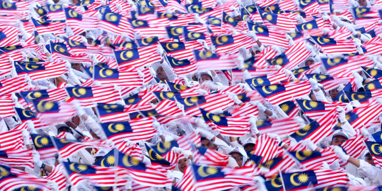 Malaysian students waves national flags during the 60th Independence Day celebrations at the Independence Square in Kuala Lumpur, Malaysia on Aug. 31, 2017.