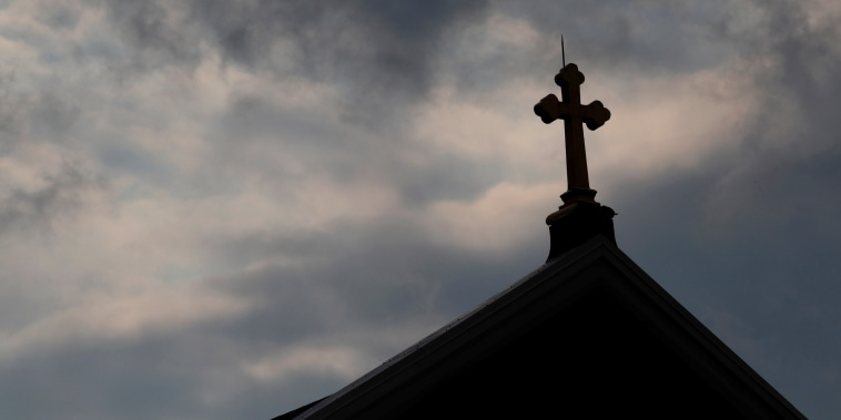 Image: Storm clouds pass over a Roman Catholic church in Pittsburgh