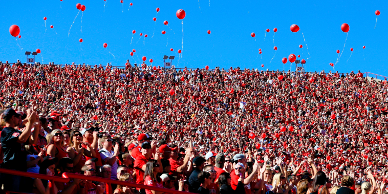 Image: Balloons are released after a Nebraska touchdown against Southern Miss