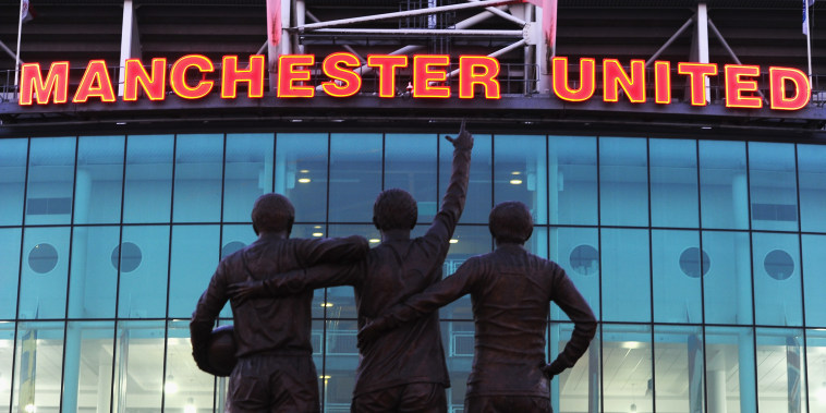 Image: Statue outside of Old Trafford in Manchester, England