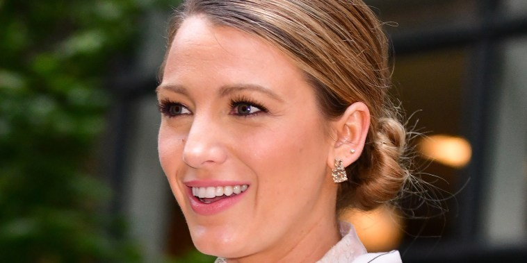 Blake Lively layered a lacy, sheer blouse underneath her final pantsuit of the weekend.