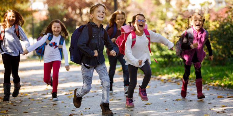 School kids running in schoolyard