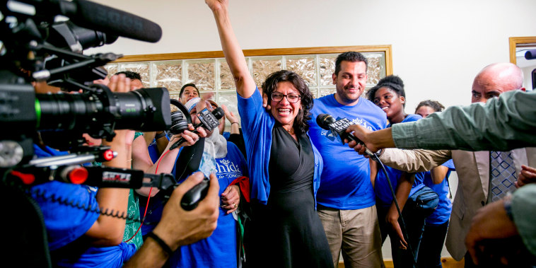 Image: Rashida Tlaib celebrates at her campaign headquarters in Detroit after winning the Democratic primary race to succeed longtime Rep. John Conyers (D-Mich.) on Tuesday, Aug. 7, 2018.