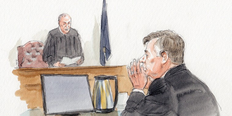 Image: Paul Manafort sits as Judge Ellis reads a note from the jury