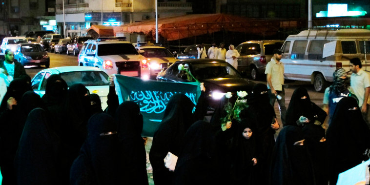 Demonstrators march during a protest in Qatif