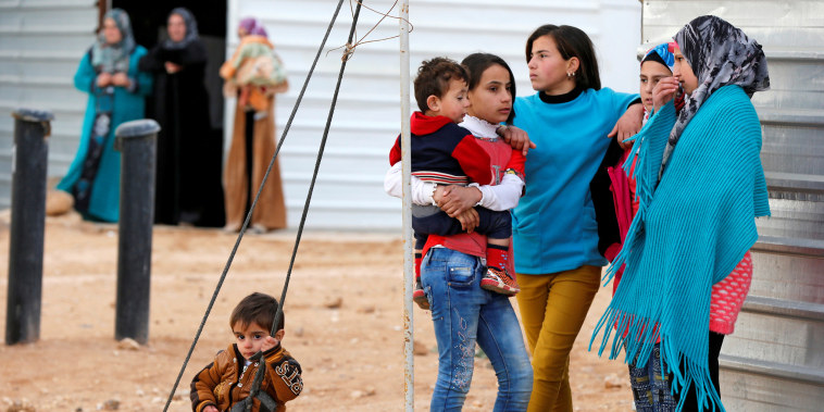 Syrian refugees wait for the arrival of actor Angelina Jolie, UNHCR Special Envoy, at the Al Zaatri refugee camp