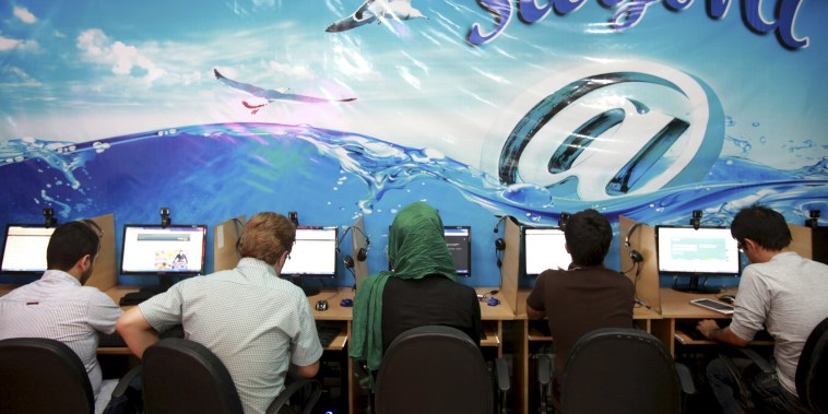 Iranians surf the Internet at a cafe in Tehran, Iran