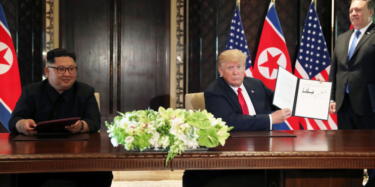 U.S. President Donald Trump shows the document, that he and North Korea's leader Kim Jong Un signed at their summit in Singapore
