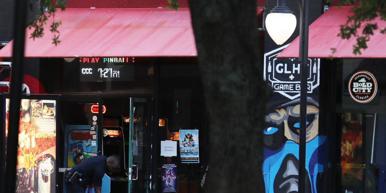 Image: Law enforcement officials investigate a shooting in the GLHF Game Bar