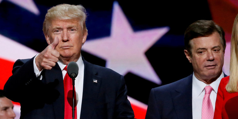 Image: Republican presidential nominee Donald Trump gives a thumbs up as his campaign manager Paul Manafort looks on during Trump's walk through at the Republican National Convention in Cleveland