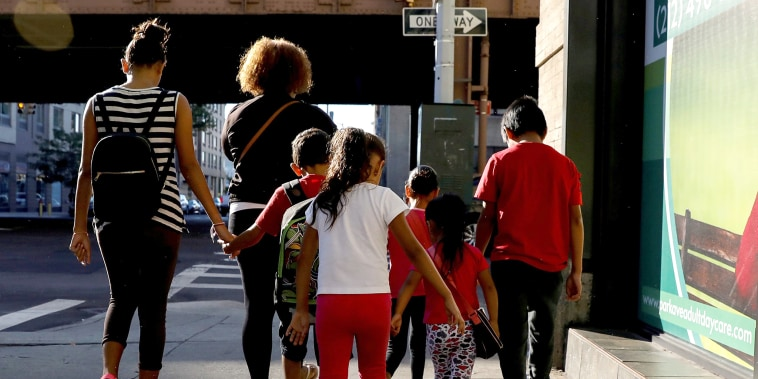 Image: Children are escorted to the Cayuga Center, which provides foster care and other services to immigrant children separated from their families, in New York