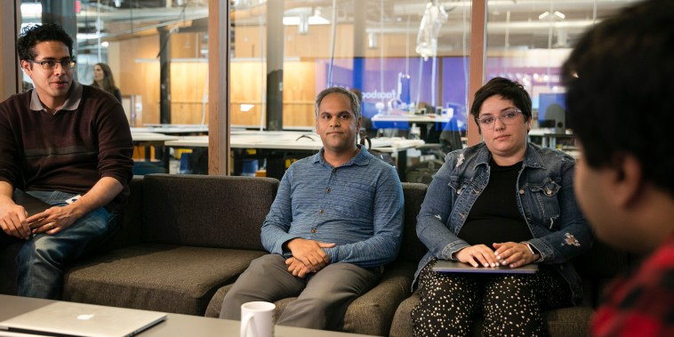 """Image: Samidh Chakrabarti, product manager of Civic Engagement, center, during a meeting at Facebook headquarters' """"situation room"""""""