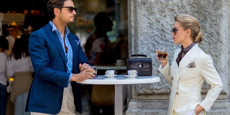 Image: A couple drink Italian coffee outside Jil Sander during the Milan Men's Fashion Week