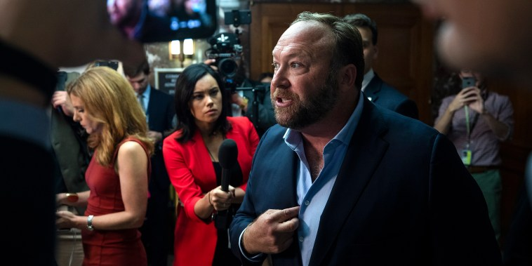 Image: Alex Jones protests Twitter and Facebook outside Senate hearing