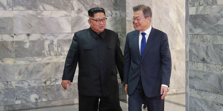 Image: South Korea's President Moon Jae-in walks with North Korean leader Kim Jong Un