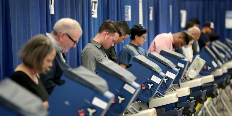 Residents cast ballots for the November 8 election at an early voting site on Oct. 18, 2016 in Chicago.