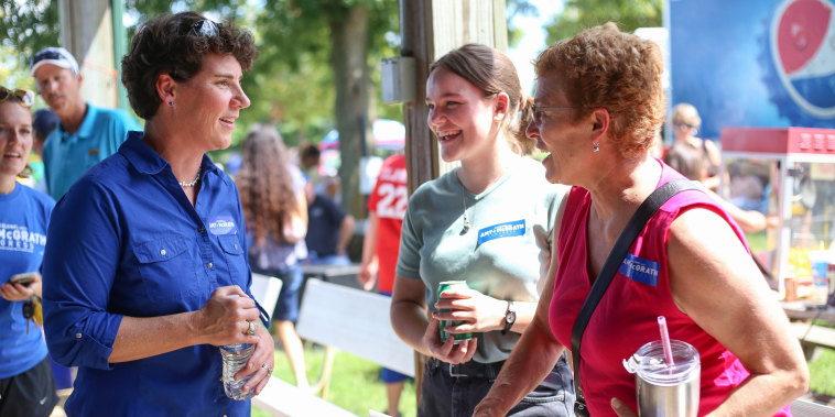Image: Democratic candidate for Congress Amy McGrath speaks with supporters