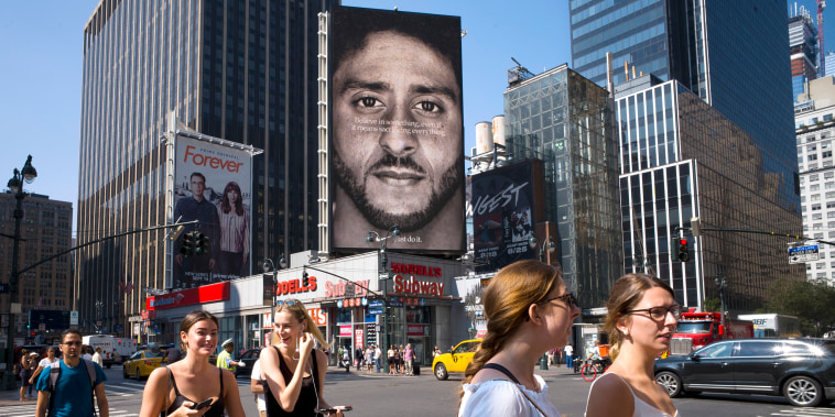 Image: People walk by a Nike advertisement featuring Colin Kaepernick on display on Sept. 6, 2018, in New York