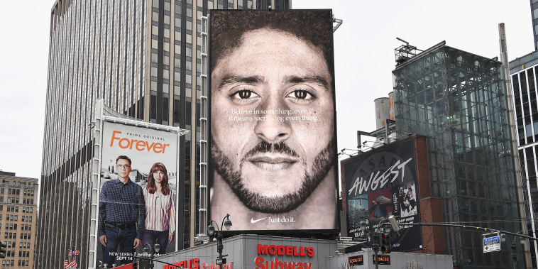 Image: A Nike ad featuring Colin Kaepernick is on display on top of a Modell's store in New York