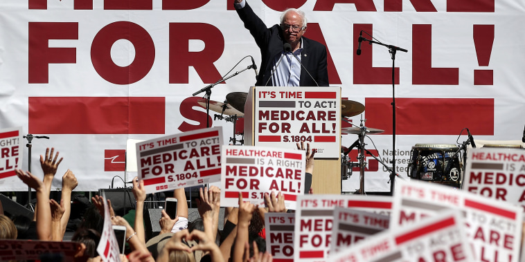 Image: Sanders speaks during a health care rally