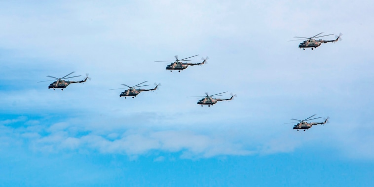 Image: Russian military helicopters fly during the Vostok 2018 exercises in Russia