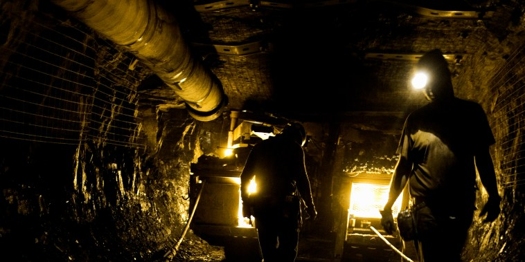 Image: Two coal miners in mine shaft