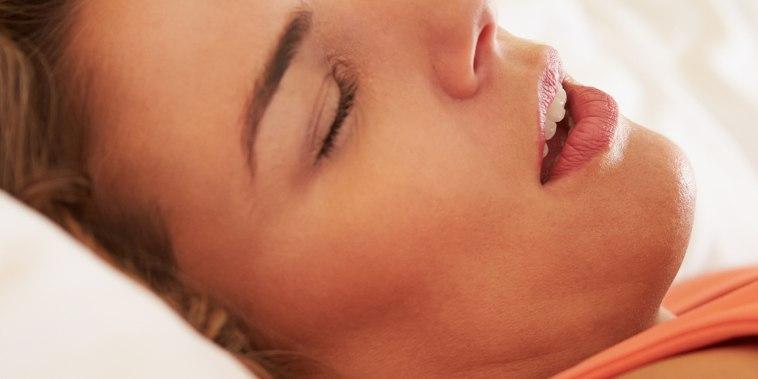 Woman Asleep In Bed Snoring