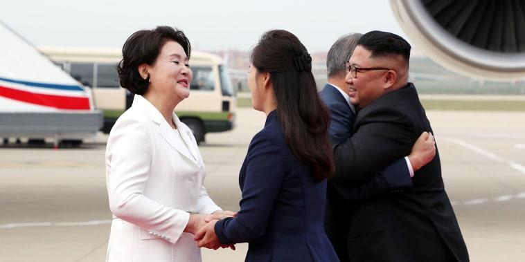 Image: North Korean leader Kim Jong Un and his wife Ri Sol Ju greet South Korean President Moon Jae-in and First Lady Kim Jung-sook