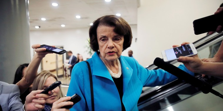 Image: U.S. Senator Feinstein talks to reporters about Kavanaugh Supreme Court nomination on Capitol Hill in Washington