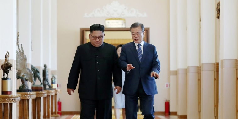 Image: South Korean President Moon Jae-in and North Korean leader Kim Jong Un arrive for their meeting in Pyongyang