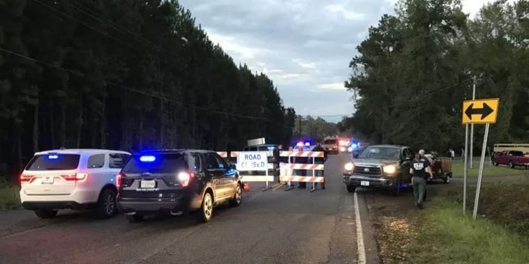 A sheriff's van was swept away in floodwaters Tuesday night near Nichols, South Carolina.
